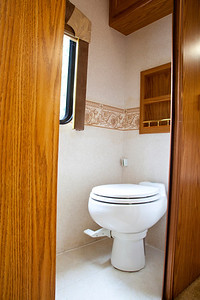 National RV Sea Breeze 5th wheel. View of private water closet with pocelian toilet and new vinyl floor.