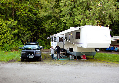 National RV Sea Breeze 5th wheel at an RV park. Exterior view of extended slides, patio canopy and underneath storage.