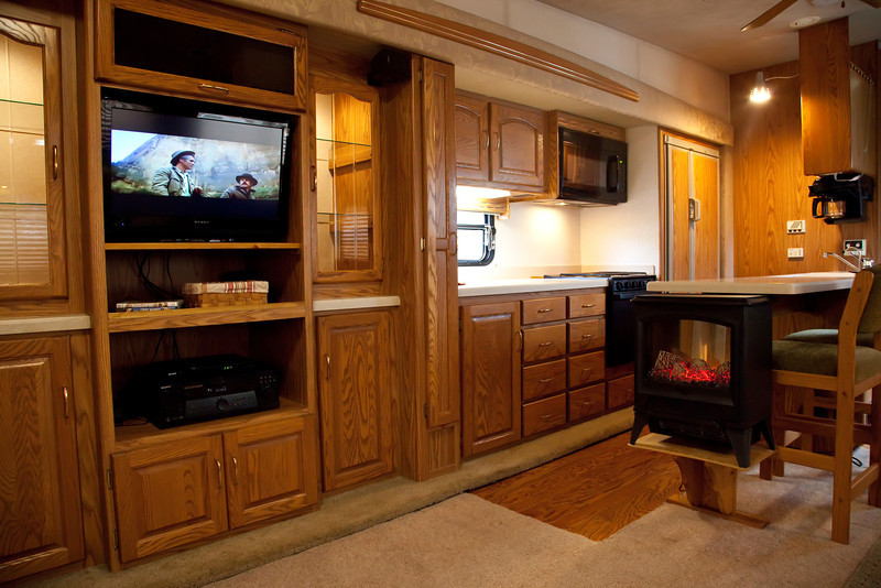 National RV Sea Breeze 5th wheel. View of entertainment center, flat screen TV, dvd player, surround sound, electric fireplace.