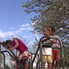 Enjoying the playground on a beautiful spring day. Renee spinning the merry-go-round while Bennah, Reayah, Zach, and Jaiden go for a ride.