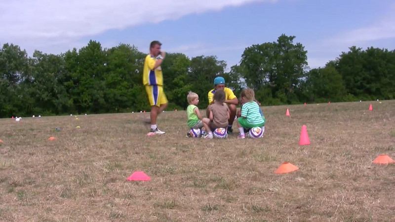 Reayah and Zach's Soccer Camp - Bennah filming and narrating