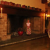 Diane standing inside the hearth of an Ahwahnee fireplace