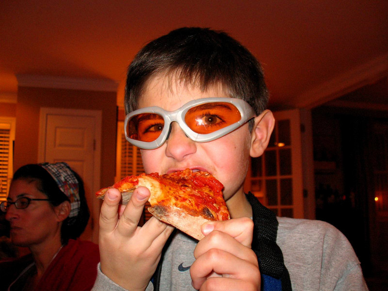A Super Dude catching up on his pizza.
