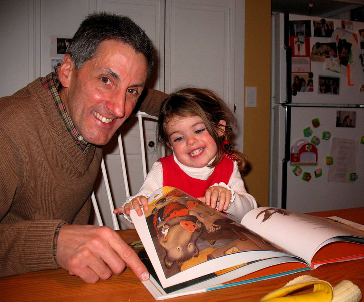 Uncle Tom helping Ella read her new book about Josephina Havelina.