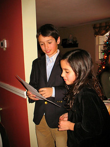 Tommy and Genna reading their poem before dinner.