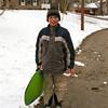 Tommy sledding.