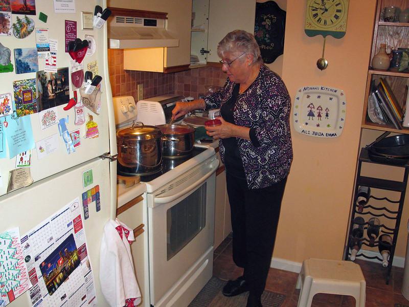 Mom cooking on Christmas Eve.