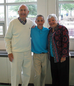 Tommy with Mom & Dad. Tommy graduates from the 8'th grade.