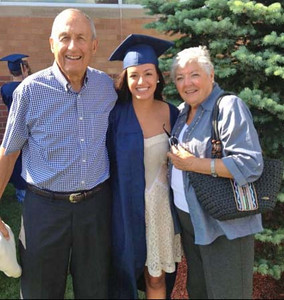 Julia with Mom & Dad. Julia graduates from her senior year in High School.