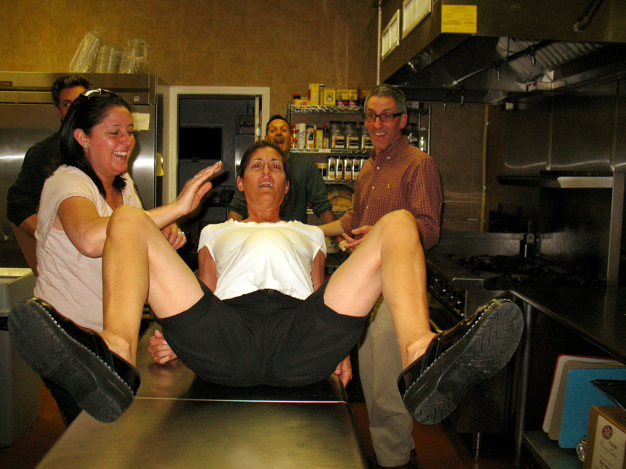 Late Saturday Night: Everyone is tired in the Dish kitchen. Lea giving birth to a mini-soccer ball.
