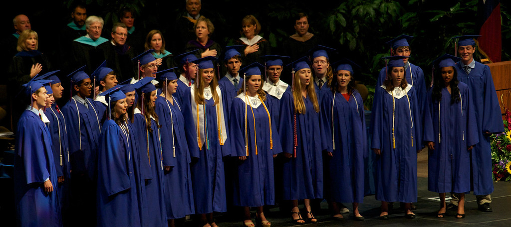 Madrigals sing the National Anthem at graduation.
