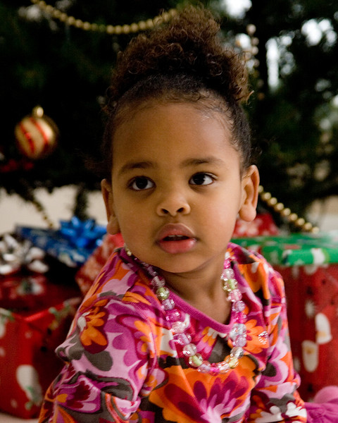 Amara in front of the Christmas tree