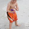 Adrik examines a shell