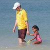 Jeremy and Amara wade near the shore
