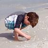 Adrik inspects a shell