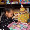 Amara opens a birthday gift