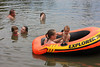 Jennifer M Sparks with Cassidy Cheney in the boat and in the water is Sabrina M Sparks holding Kelsey Cheney, C Wayne Price and Pamela S Price