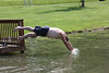 C Wayne Price diving into the water off the dock
