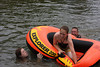 Jennifer M Sparks in the boat with Pamela S Price and C Wayne Price in the water tipping her over