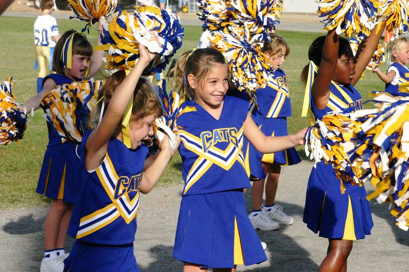 2004 My niece and Goddaughter, Anna Bastian, center with the big smile, in her first year of cheerleading.