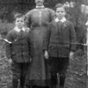 1915. My great grandmother Oakes. Her sons (the youngest son on the left was George, the other was our grandad. The eldest son was not in the picture.