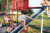 Nicole climbing up slide