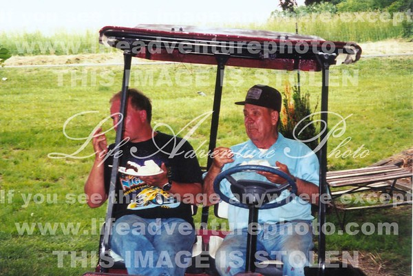 Dale Stephen eating cake on golf cart
