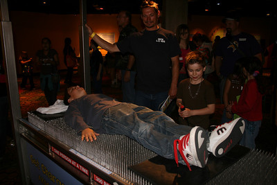 Kevin on the bed of nails....Ron & Noah watching over him :)
