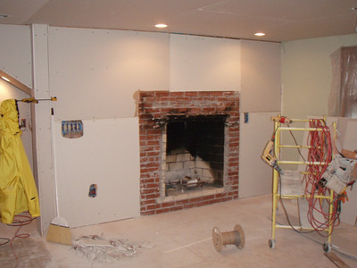Another layer of drywall still needed on this wall to eliminate a 'bump out' for the fireplace.