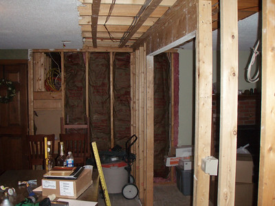The wall between the 2 rooms is being replace by an engineered beam.