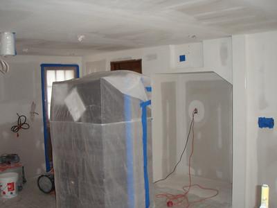 Drywall sanding in progress.