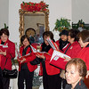 We all sang with the carolers.