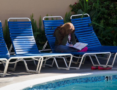 Sommer does homework while Elia swims.