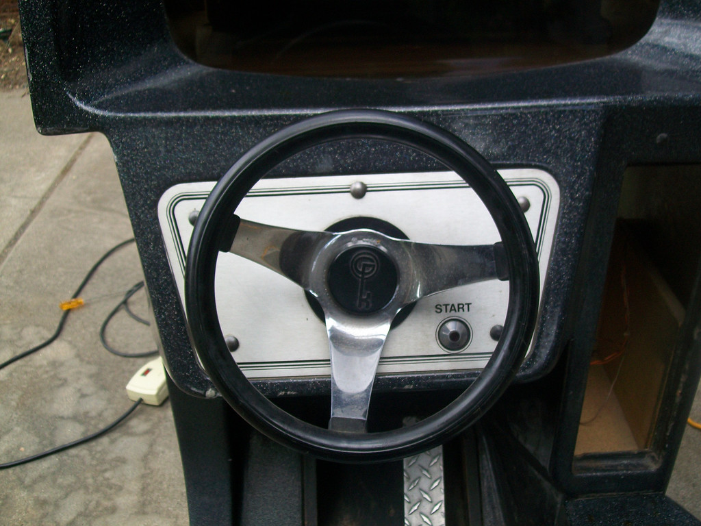 "Notice, the logo on the steering wheel, not Atari. I noticed there was an old note inside the machine ""steering not working"", they probably put a different assembly in it at some point."