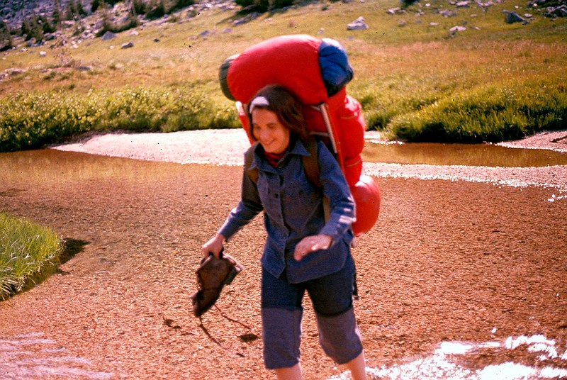 Judy fords a tributary of the Copper river in the North Cascades, 1976.