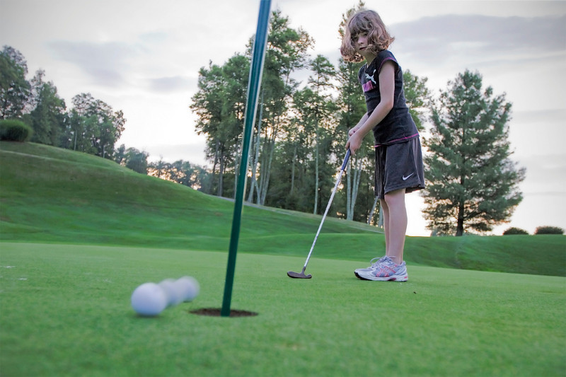 Stella, first golf lesson<br /> Mountain Air, July 21, 2010<br /> (The sun had set, it was almost dark.)
