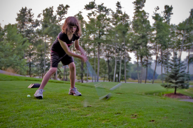 Stella, first golf lesson<br /> Mountain Air, July 21, 2010