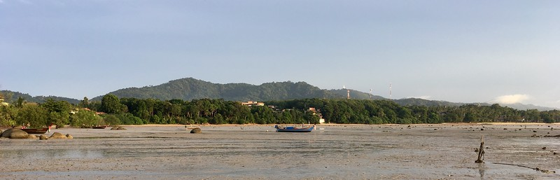Low tide. The white on the top of the right hill is the Big Budda