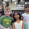 Elliot, Nita, and Aahana at the school dance.