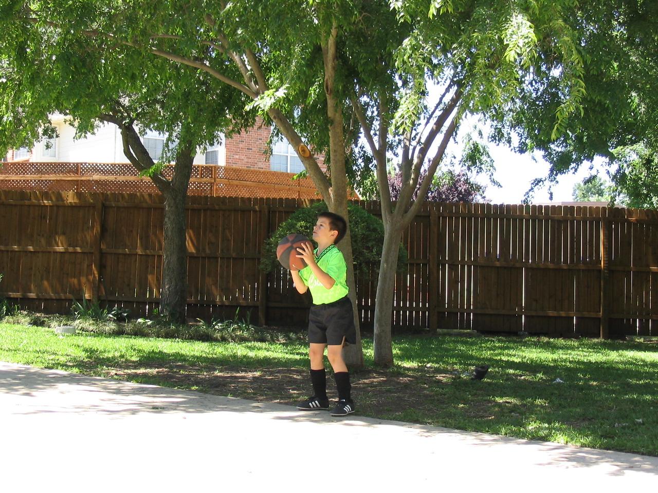 Reid shooting hoops before his soccer game...makes perfect sense.