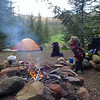 Elliot blowing the campfire smoke!  The stove did work this trip, but the boys (all three of them!) wanted a camp fire.