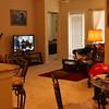 Living room from ldry room door.  King Master Suite thru far door, outside patio thru door with blinds.
