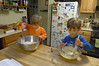 Making the birthday cake!  One bowl for wet ingredients, one for dry!