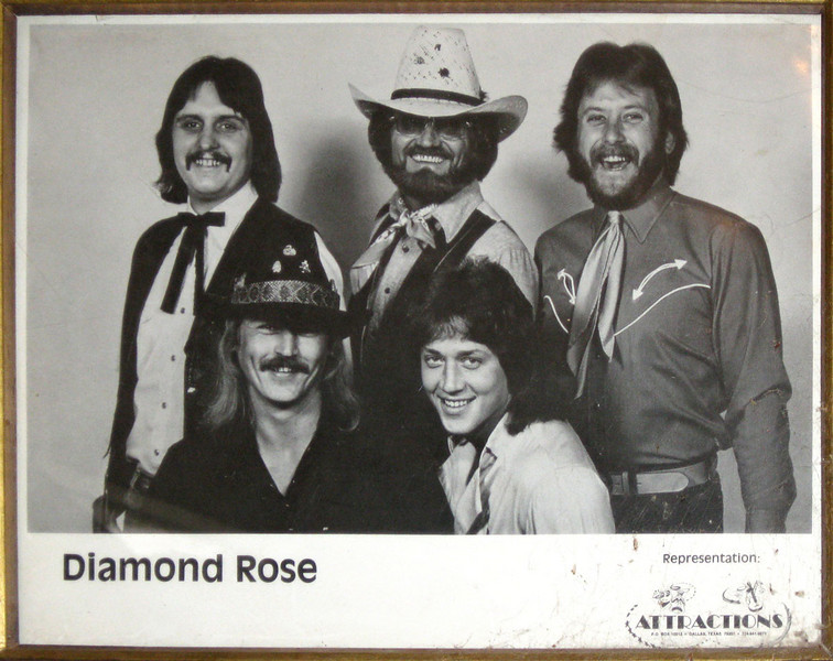 DIAMOND ROSE<br /> Alton used to play in the band Diamond Rose, led by none other than Johnny Rodriguez (back row, center). That's Alton on the left in the front row.
