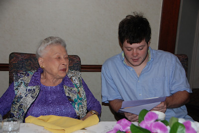 Jonathan continues tradition ....reading cards to Nana.