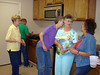 KITCHEN DOINGS<br /> And here we are getting things ready for lunch -- or some of us are, anyway. We've finally caught up with Peggy now. This is Nelda, Sonny (cooking hot dogs), Joan, Peggy, and Lyn.