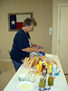 EILEEN BUSY WITH PREPARATIONS<br /> Eileen gets things ready by setting up the condiments table.
