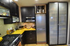 "Refrigerator wall with new Ikea pantry and 24"" 10 cu ft Euro style refrigerator."