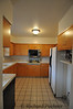 Original kitchen, just as it was installed in 1965.  Notice soffit above upper cabinets and classic electric cook top/oven