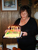 LYN BLOWING OUT THE CANDLES<br /> And I don't think there are enough. Of course, if we'd put the full amount on there, it might've taken the Volunteer Fire Department to put it out (just kidding . . . maybe).